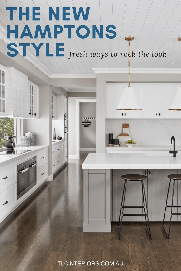 hamptons style kitchen with dark floors and white cabinetry