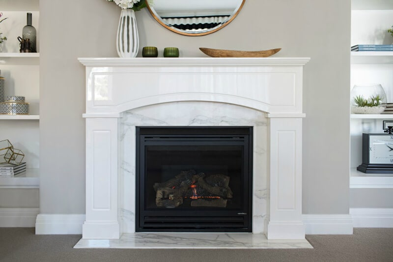hamptons-style-living-room-with-marble-fireplace-and-built-in-shelving