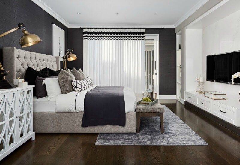 hamptons-style-master-bedroom-with-tufted-headboard-and-dark-floor