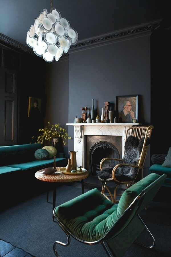 jewel tone interiors emerald green armchair and deep teal sofa with charcoal grey feature wall