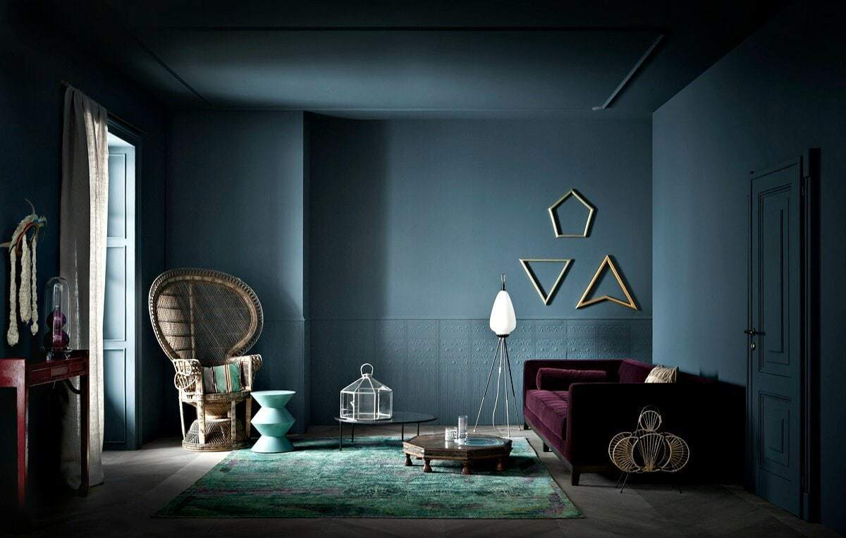 jewel tone interiors purple sofa and deep teal wall