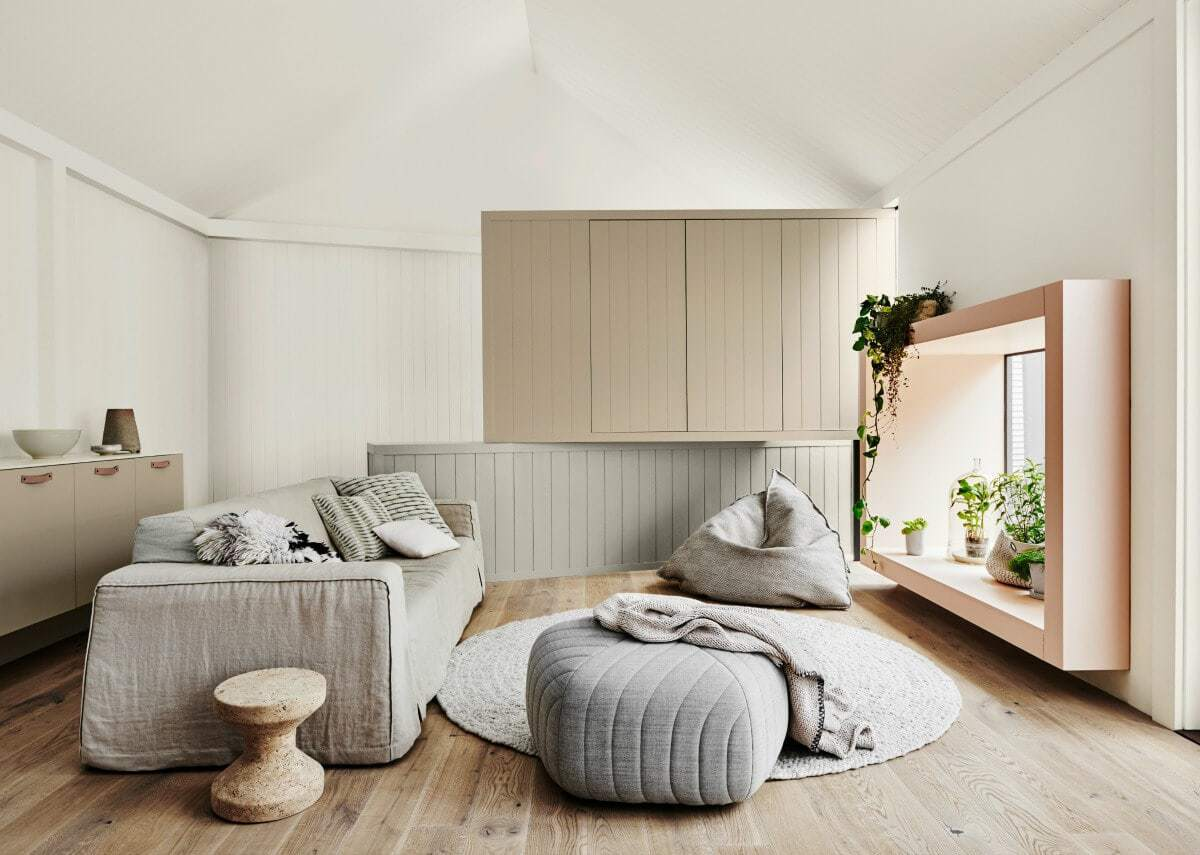 beige-living-room-with-soft-grey-sofa-cover-and-beanbags