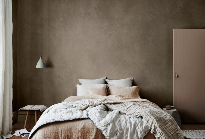 beige-textured-feature-wall-in-beige-bedroom-with-linen-bedding