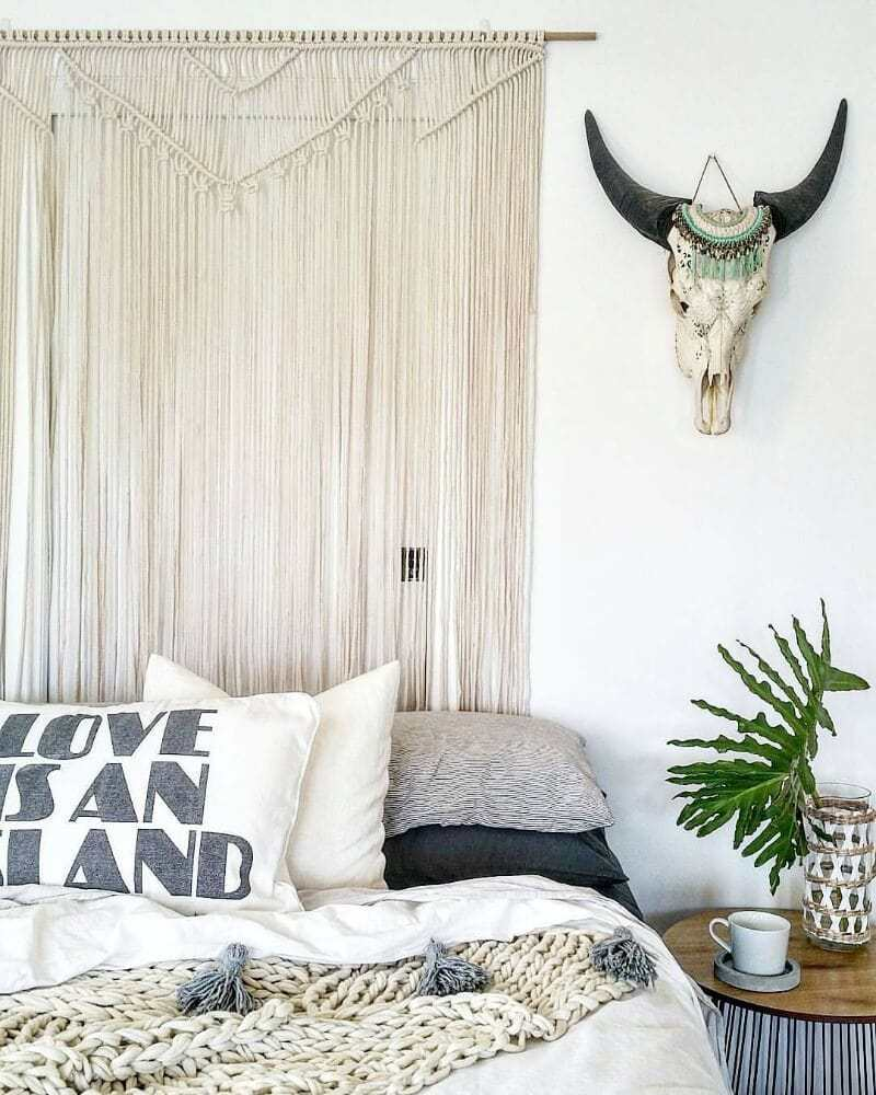 Bohemian Interior Bedroom With Macrame Headboard By