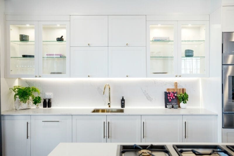 the-block-2016-julia-and-sasha-kitchen-with-white-cabinets-and-gold-handles