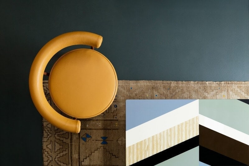 deep-teal-paint-with-round-orange-dining-chair-from-haymes-paint