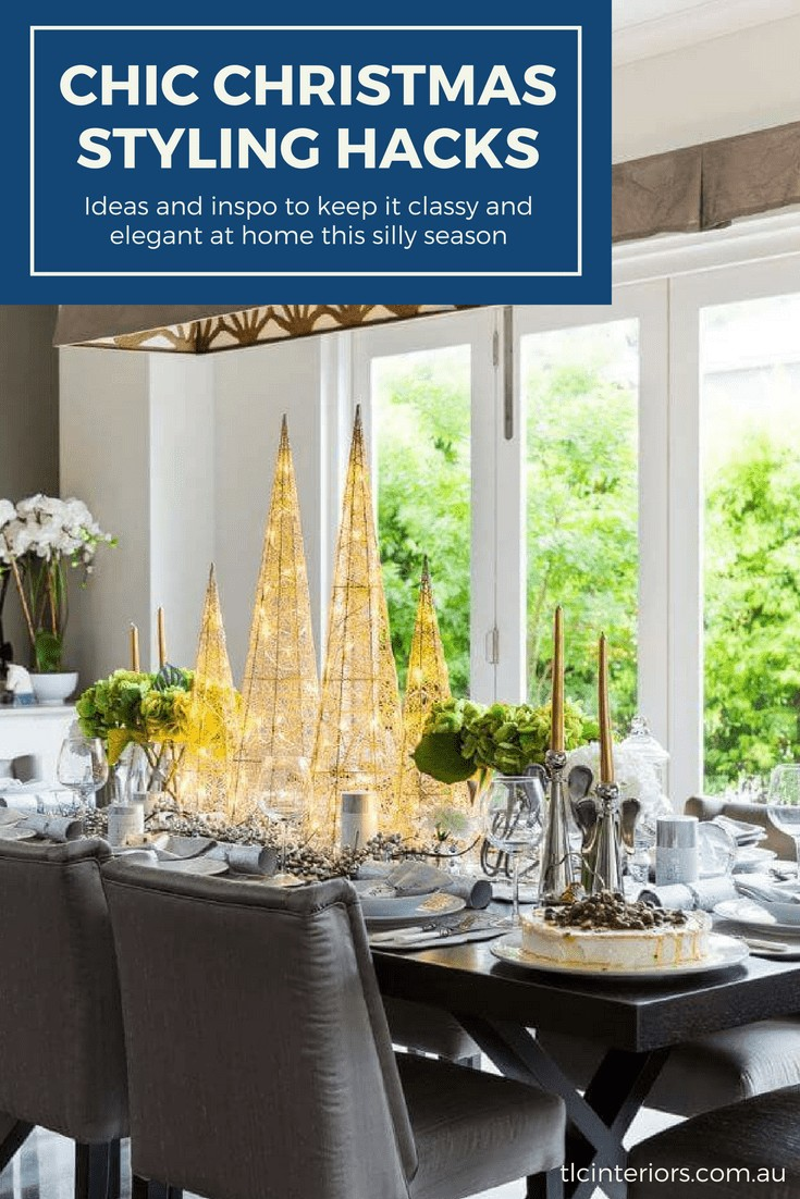 elegant christmas table setting with christmas trees on dining table