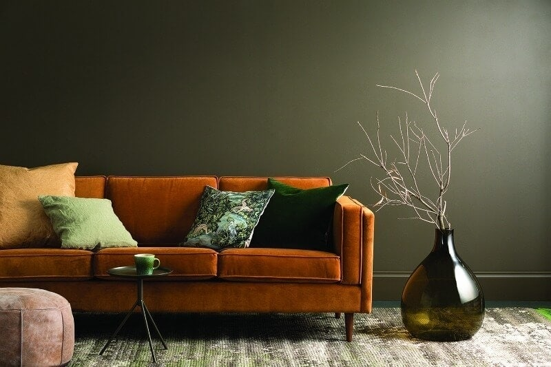 haymes-paint-dark-gree-feature-wall-with-orange-velvet-sofa