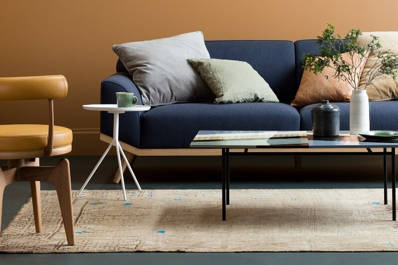 orange-feature-wall-with-blue-sofa-from-haymes-paint