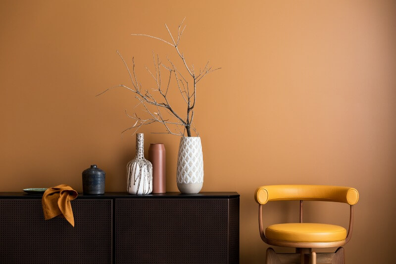 strata-orange-paint-from-haymes-with-dark-brown-sideboard-walls-with-colour