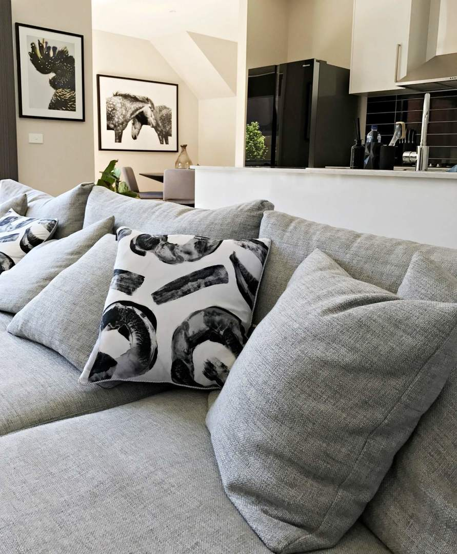 black and white cushion on grey sofa with urban road art the life creative