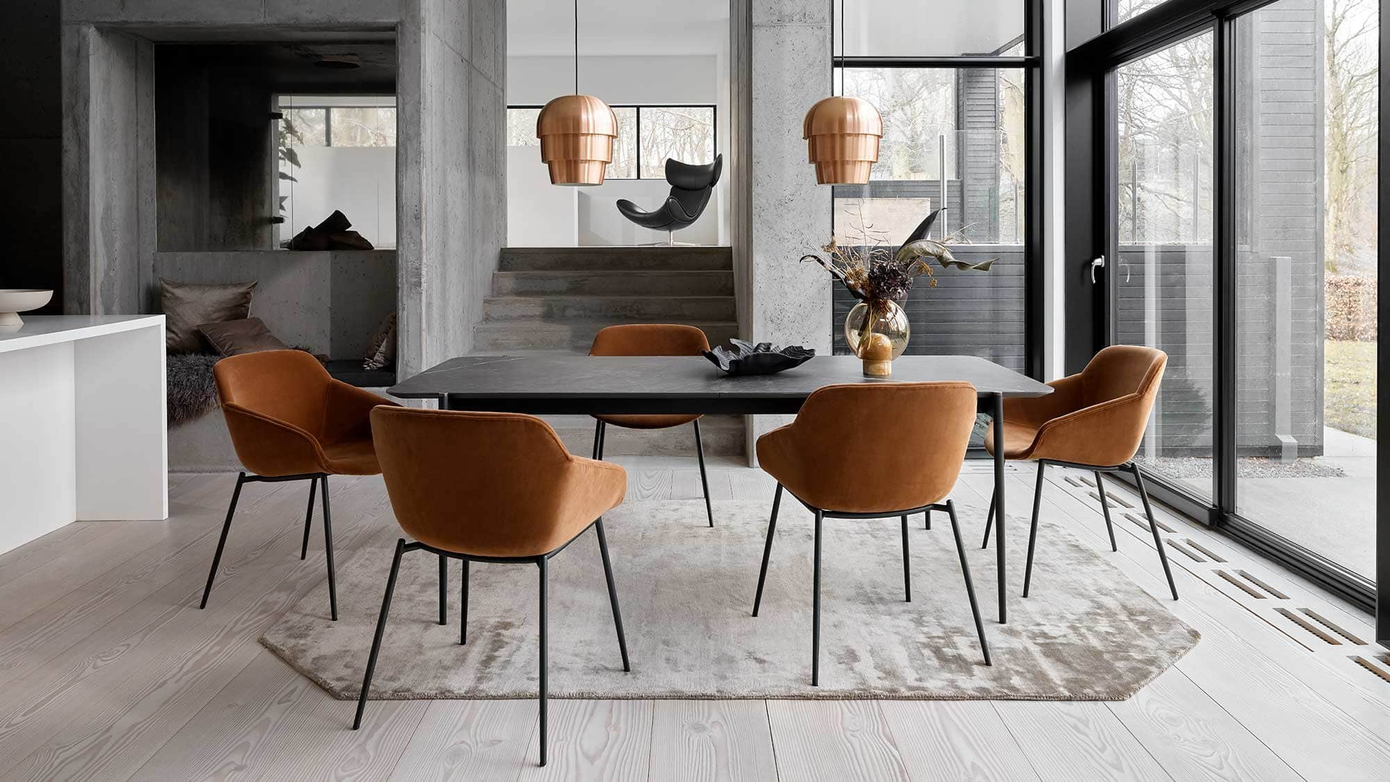 boconcept tan velvet dining chairs with black legs in masculine dining room