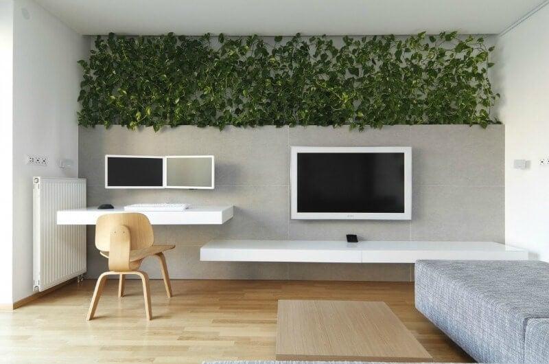 indoor vertical garden in living room with built in desk