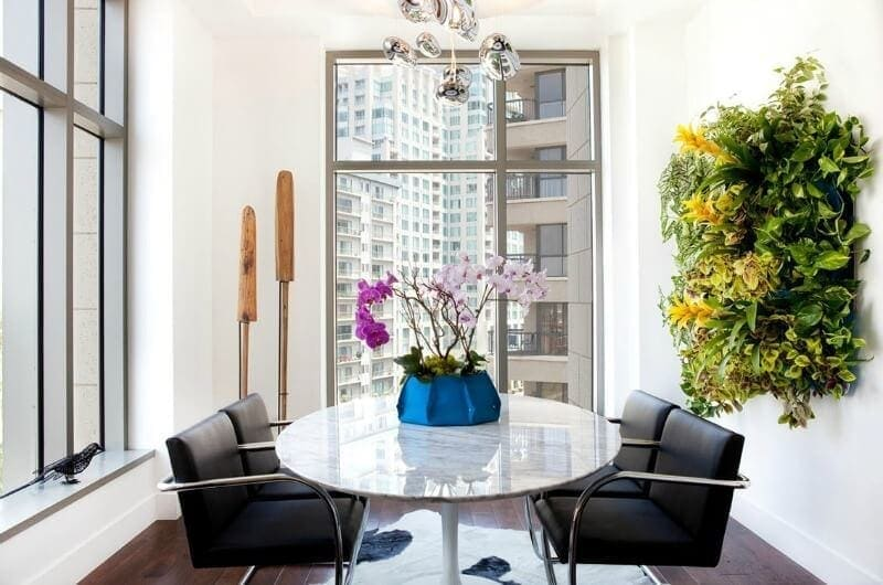 indoor vertical garden in modern city apartment with marble dining table