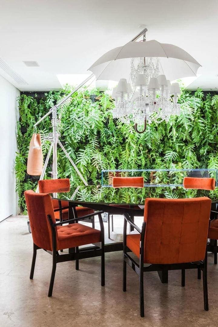 refreshing-indoor-vertical-garden-idea-growing-inside-the-orange-dining-room-interior-enlightened-by-skylights