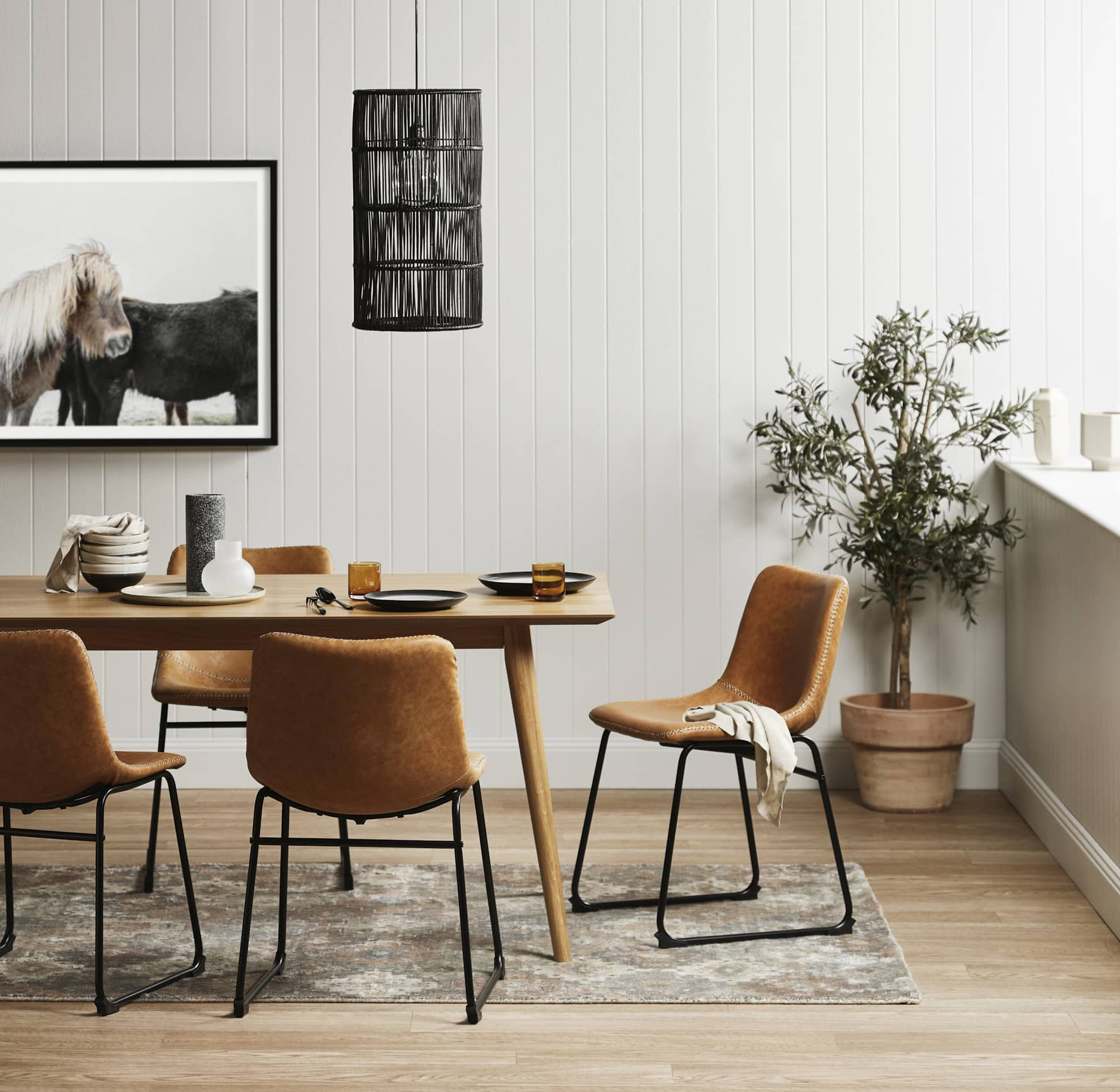 temple and webster tan leather dining chairs in global dining room
