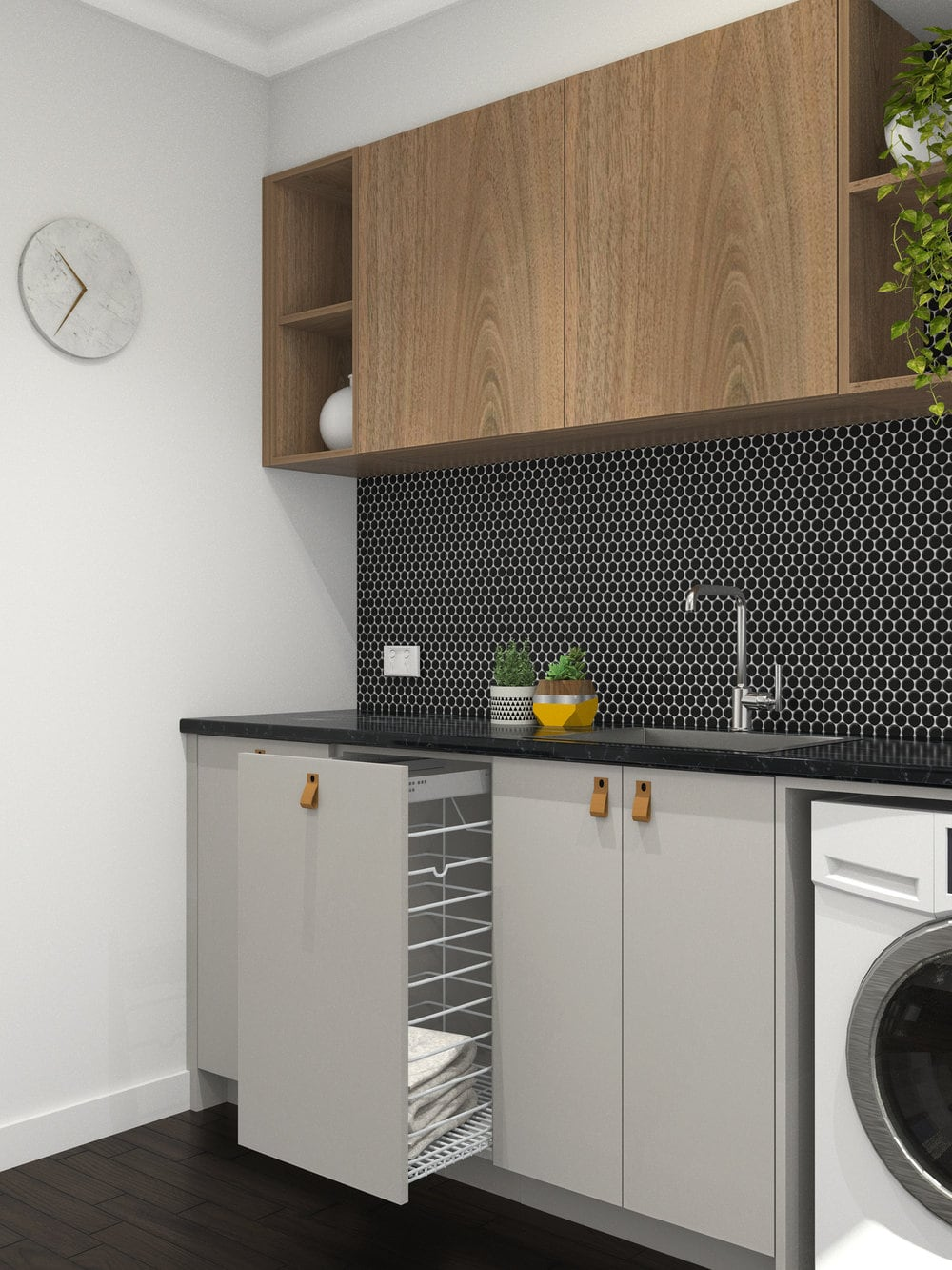 grey laundry room with black tiles and tan leather cabinetry handles