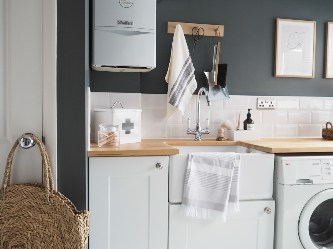 laundry room with charcoal grey walls and timber countertop