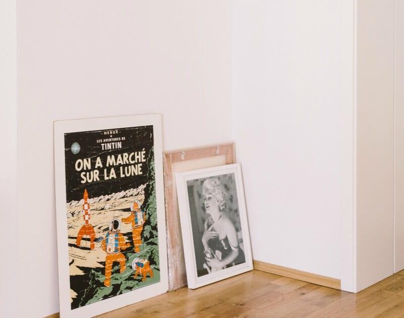 marilyn monroe artwork leaning on floor in white apartment