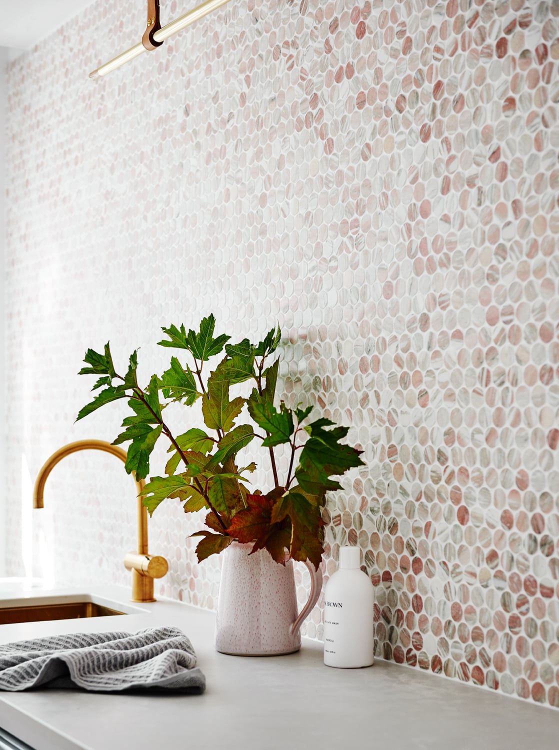 norsu home laundry blush penny round tiles and brass tap