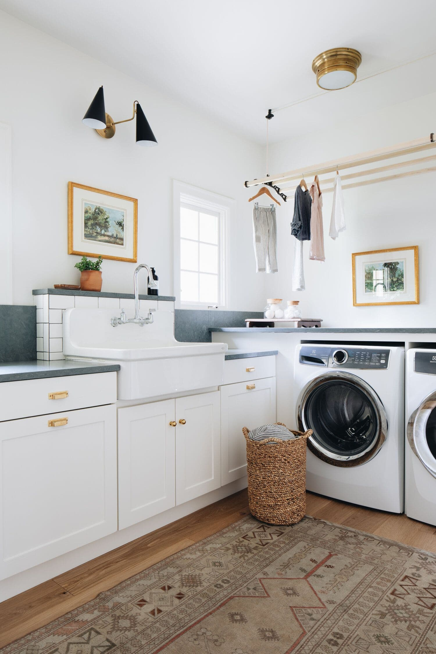 white and gold laundry room with moroccan floor rug