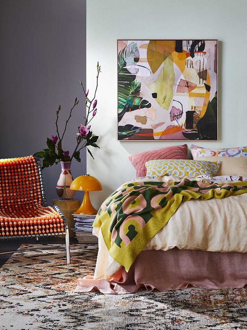 australian abstract artists georgie wilson art in bright bedroom with orange bedding