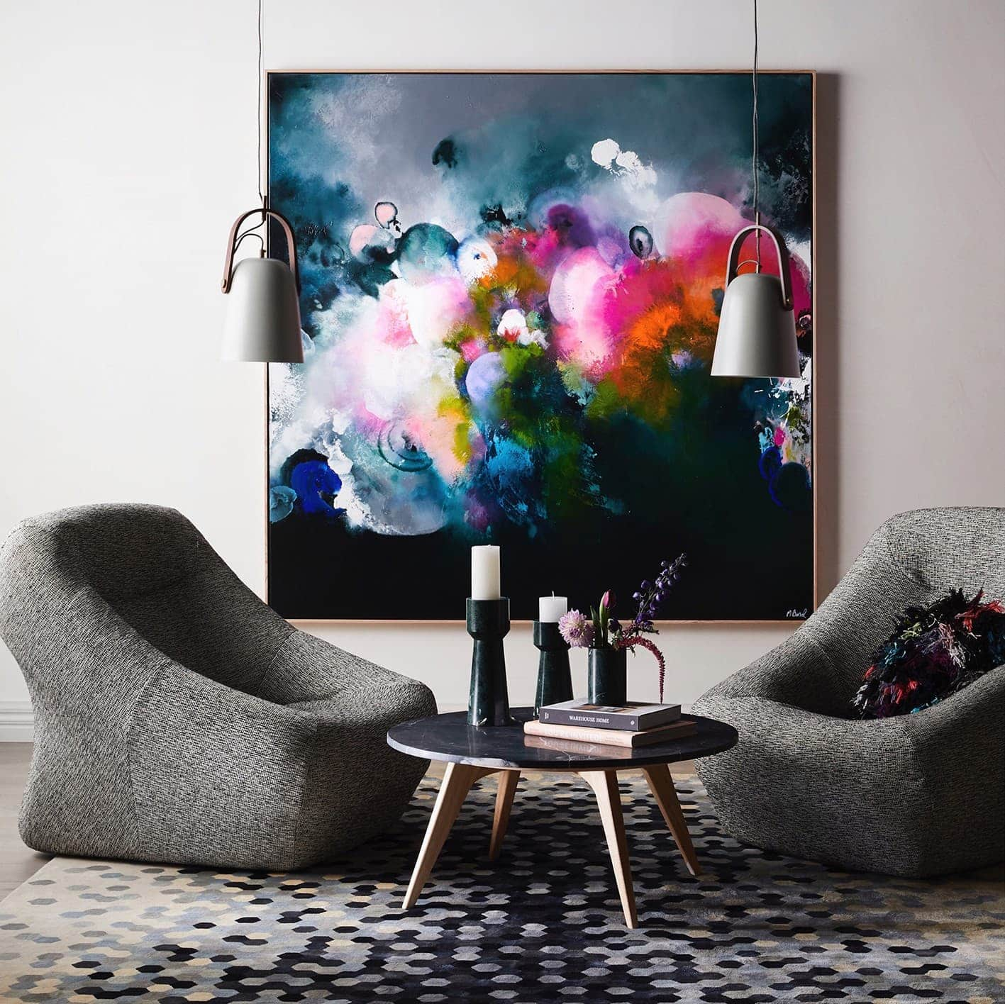 australian abstract artists michael bond colourful artwork on wall grey armchairs