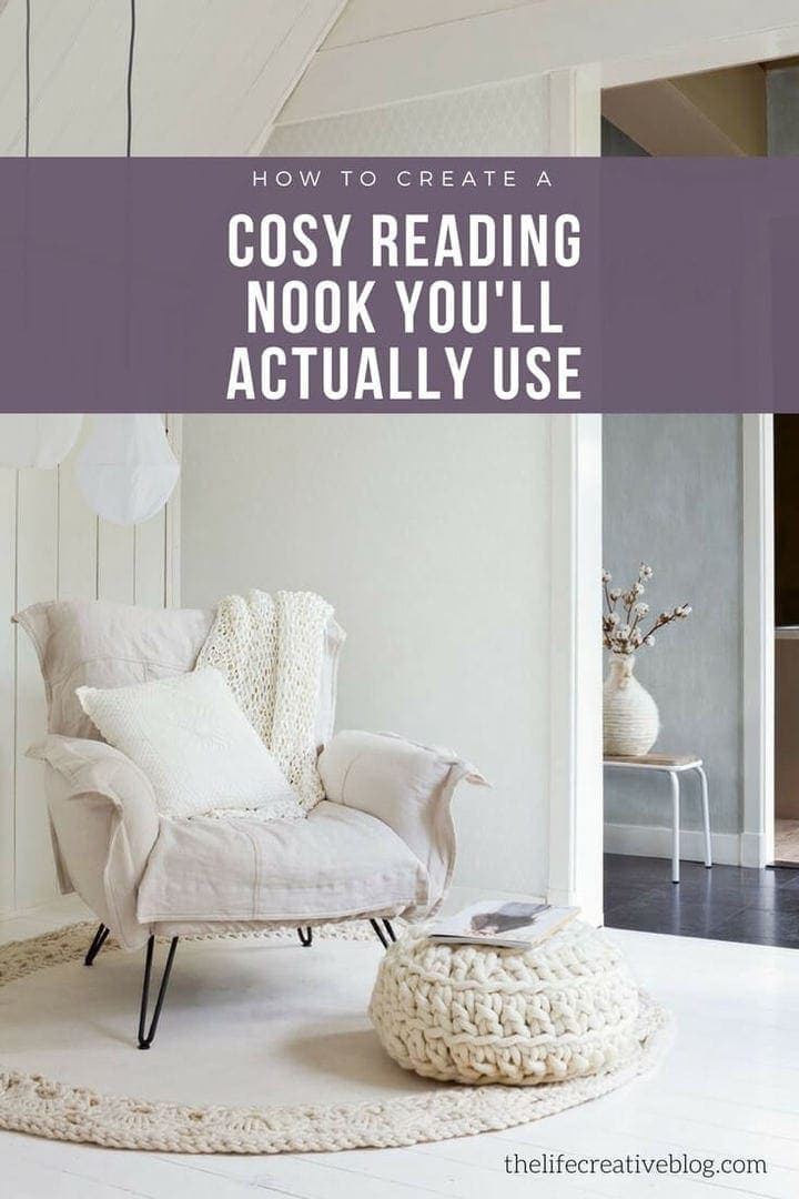 cosy reading nook featuring white linen armchair and crochet ottoman in all white living room