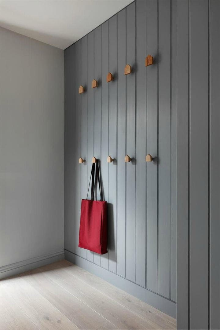 grey vertical timber cladding indoor with timber hooks and red tote bag - hallway design