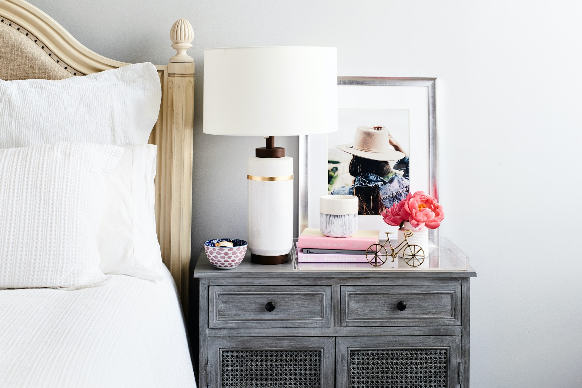 personalised bedside table styling with lamp photo frame and candle