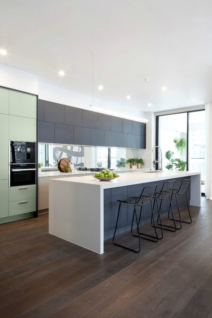 the block 2016 andy and ben kitchen with green and grey cupboards and white waterfall caesarstone benchtop