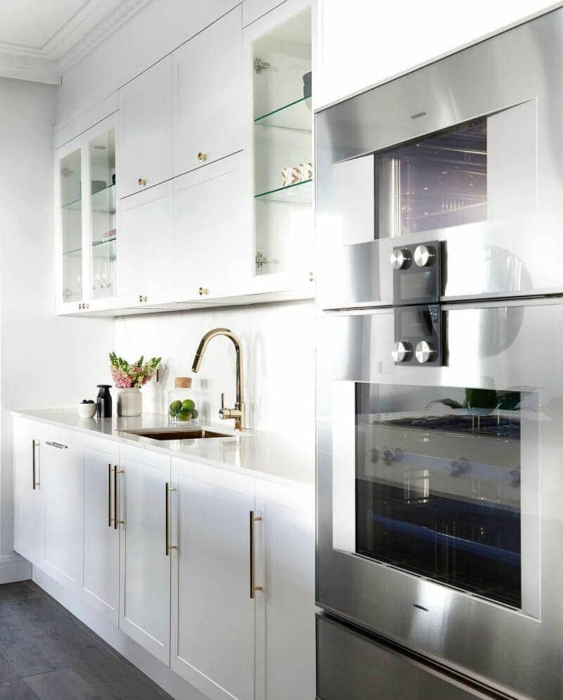 the block 2016 julia and sasha's kitchen white cabinetry with gold handles and gold tapware