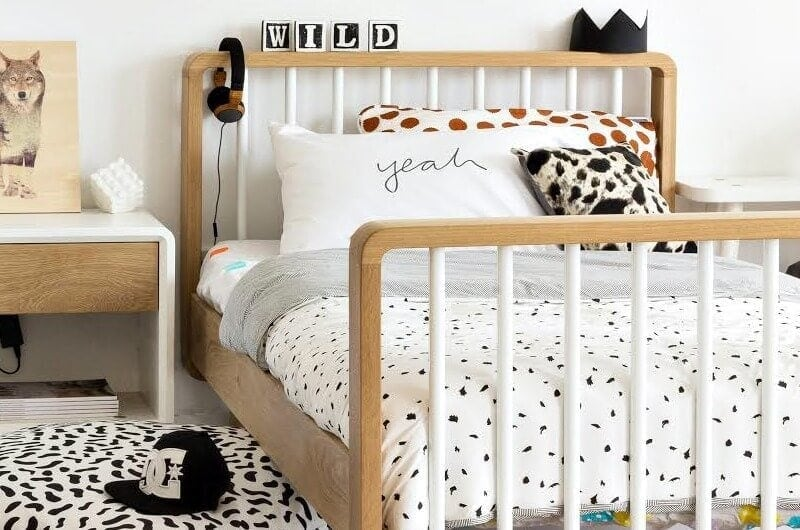 archie bed by green cathedral timber and white slat bed with black and white bedding