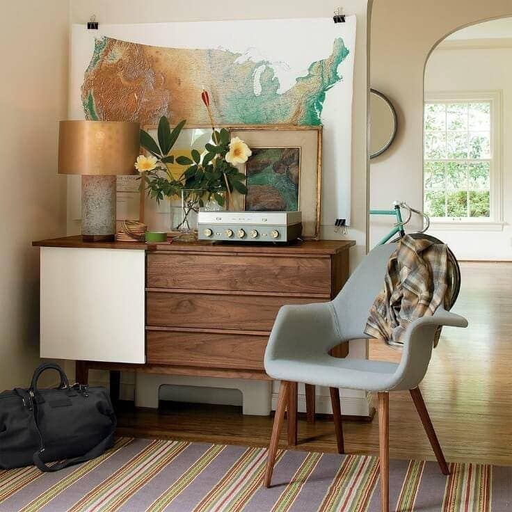 schoolhouse electric credenza with vintage record player and world map