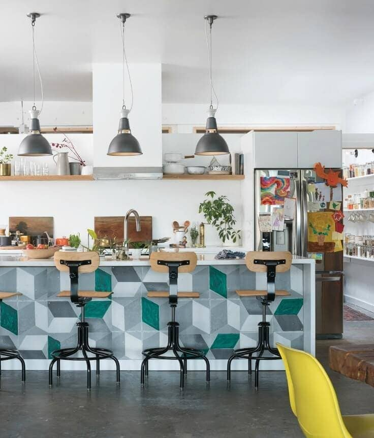 schoolhouse electric eclectic kitchen with green and grey bench tiles and grey pendant lights above bench