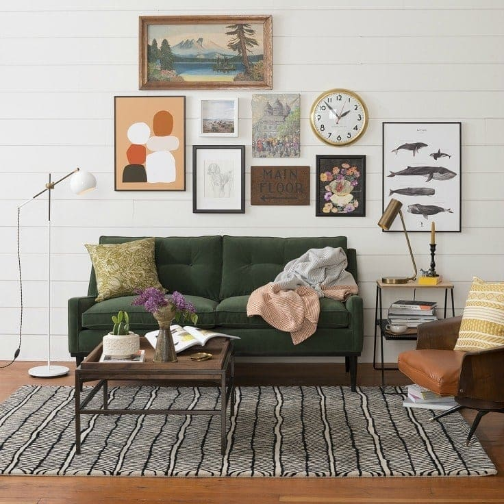schoolhouse electric living room with gallery wall and dark green sofa