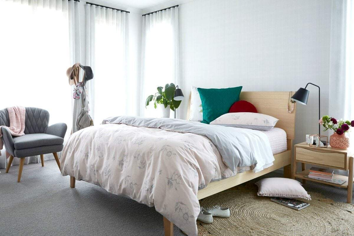 teenage girls bedroom ideas soft pink bedspread on blonde timber bed with pops of green