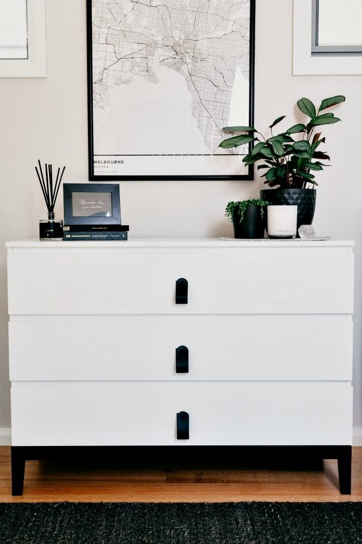 white aldi chest of drawers with black leather handles from H and G designs and plants styled on white furniture
