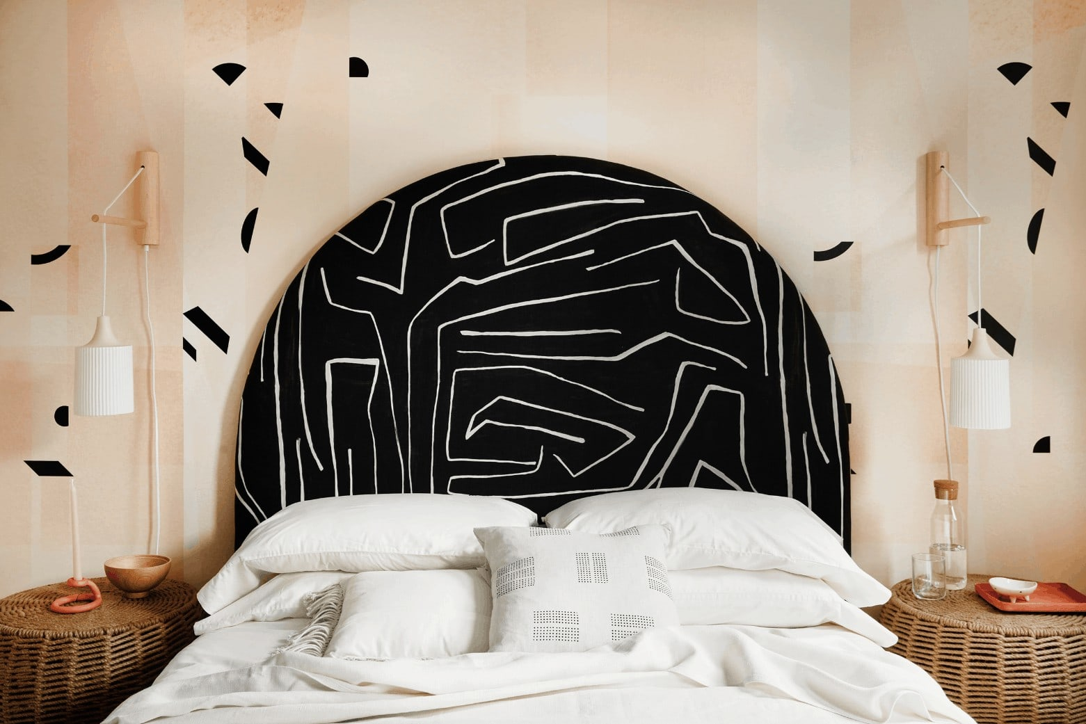 black and white pattern curved headboard in master bedroom