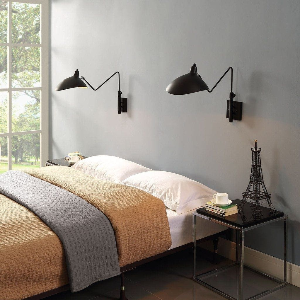 black wall sconce lights above bed in minimalist bedroom