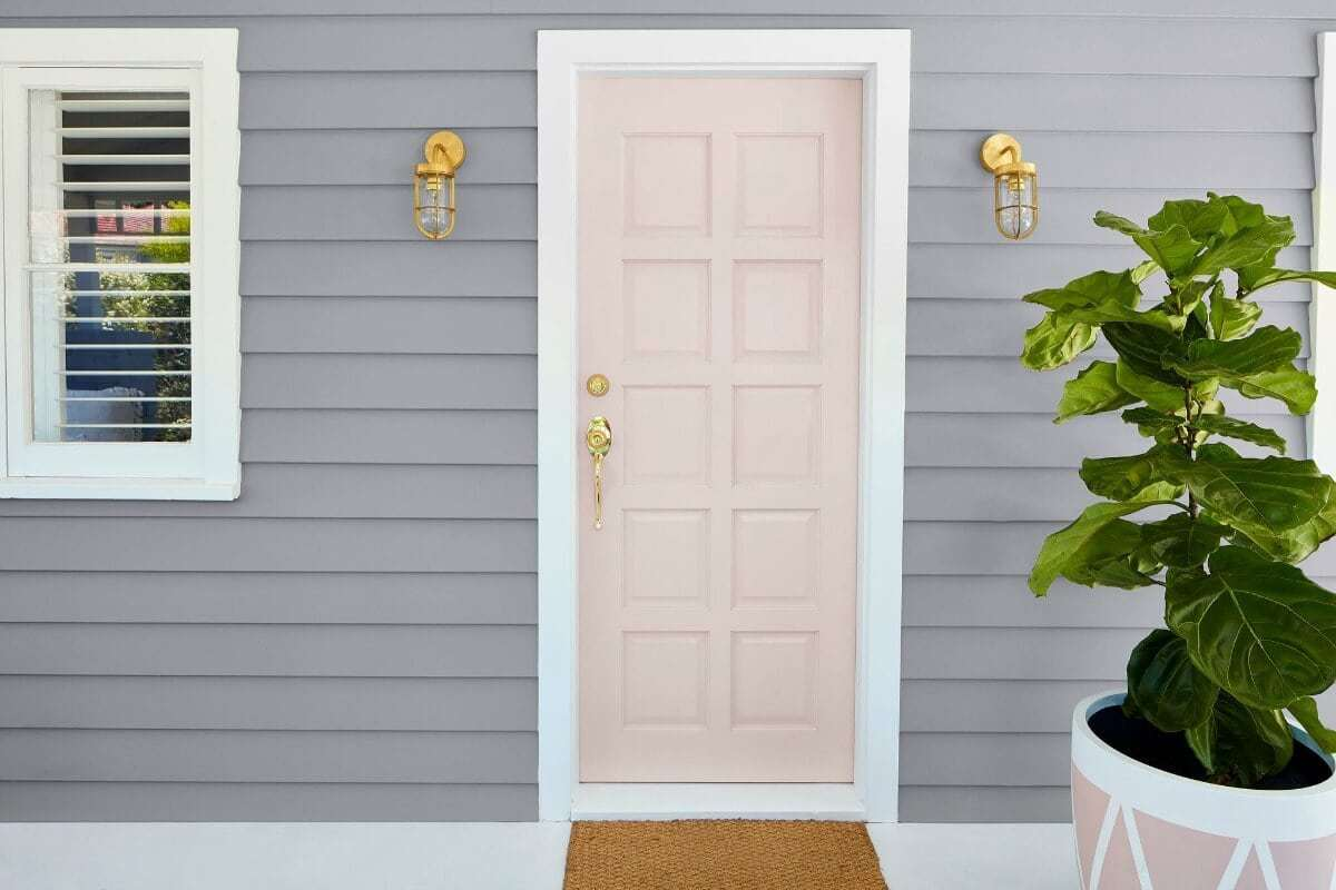 grey home with light pink front door and gold handle from taubmans paint