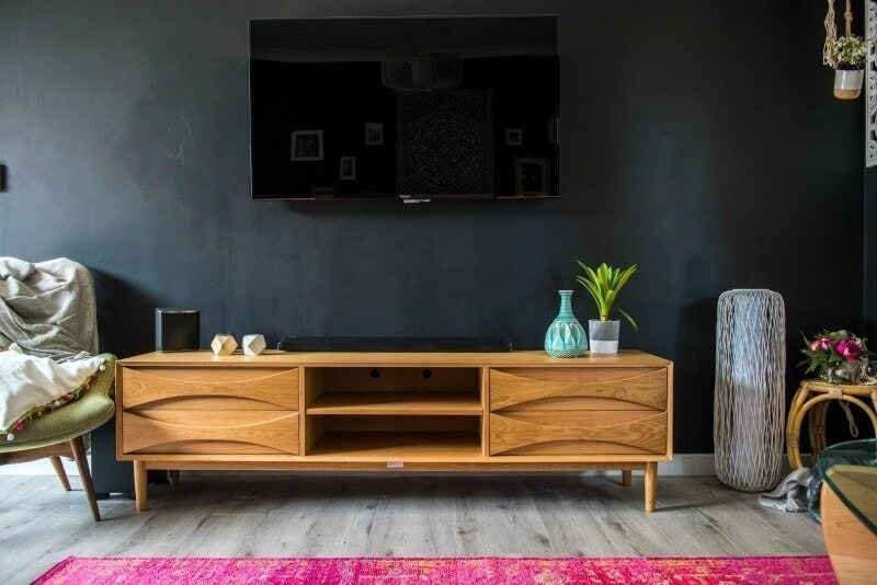 house rules 2017 living room with black walls and timber tv unit