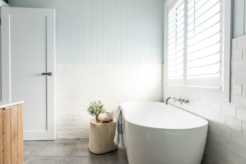 kyal and kara renovation bathroom with freestanding bath and vertical timber panelling