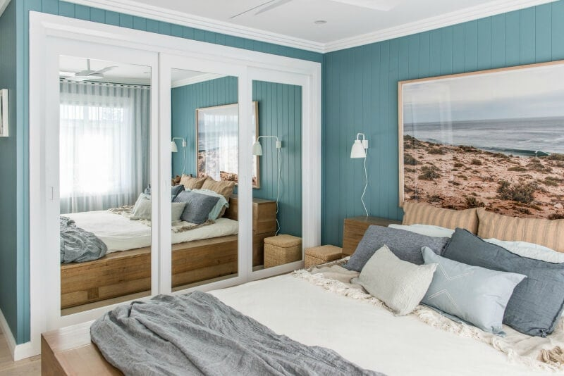 kyal and kara renovation bedroom with teal walls and coastal theme