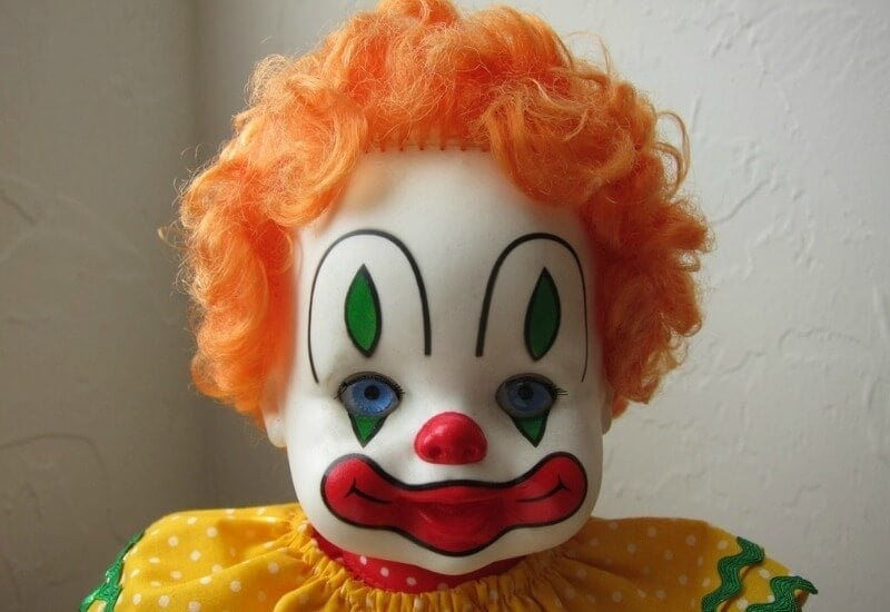ugly decor clown doll with orange hair
