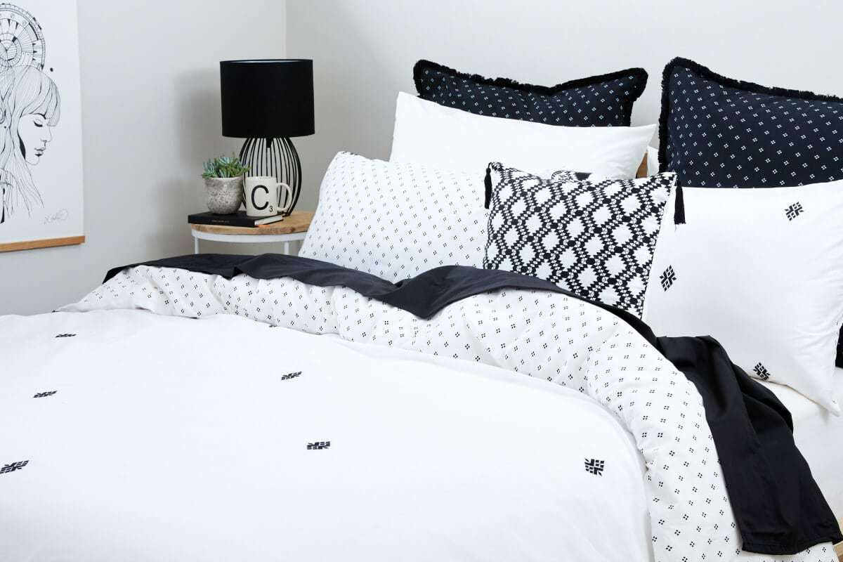 black and white bedroom styling ideas black lamp on round bedside table lorraine lea