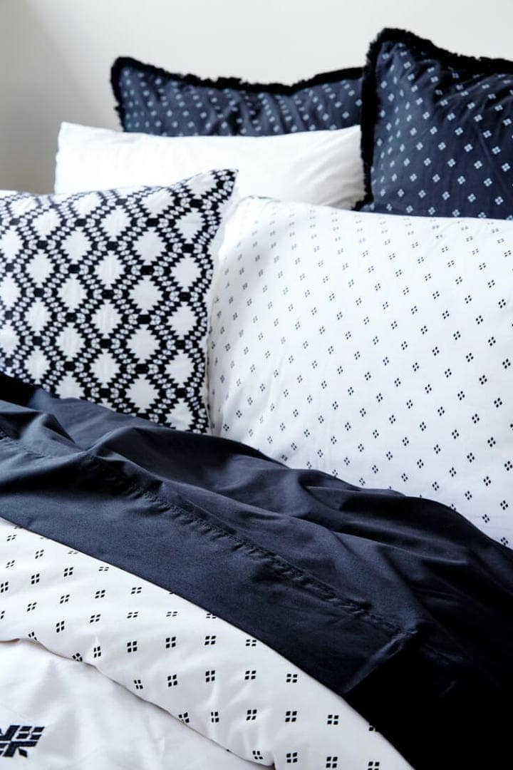 black and white nomi bedding from lorrain lea with polka dot pattern