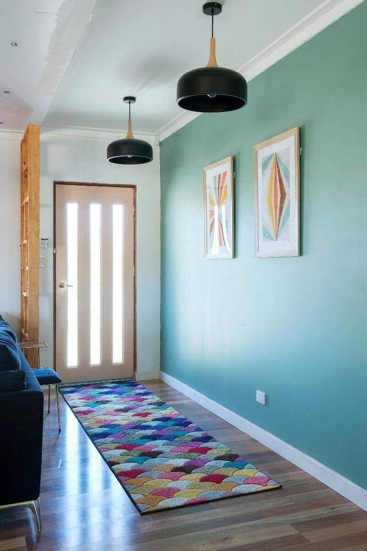 house rules 2017 andrew and jono entryway with aqua feature wall
