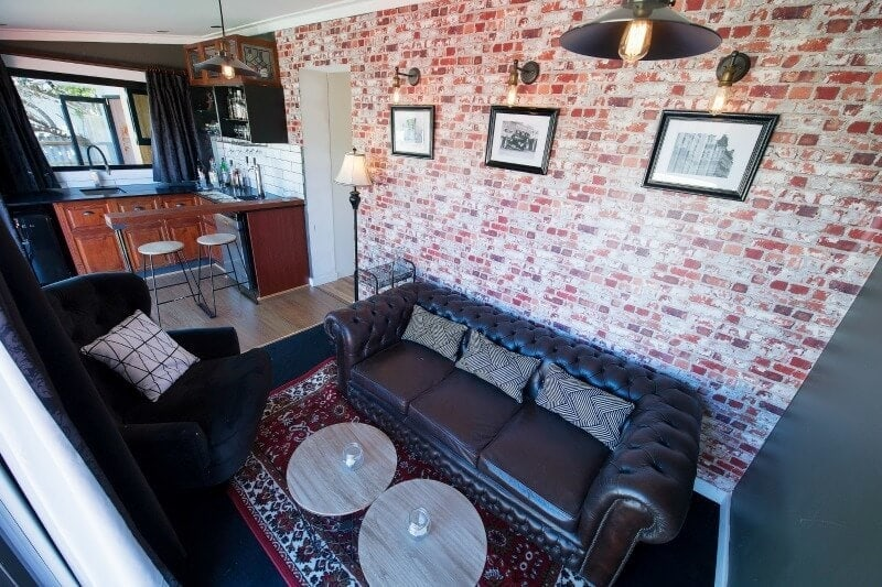 house rules 2017 andrew and jono speakeasy man cave with brick wallpaper