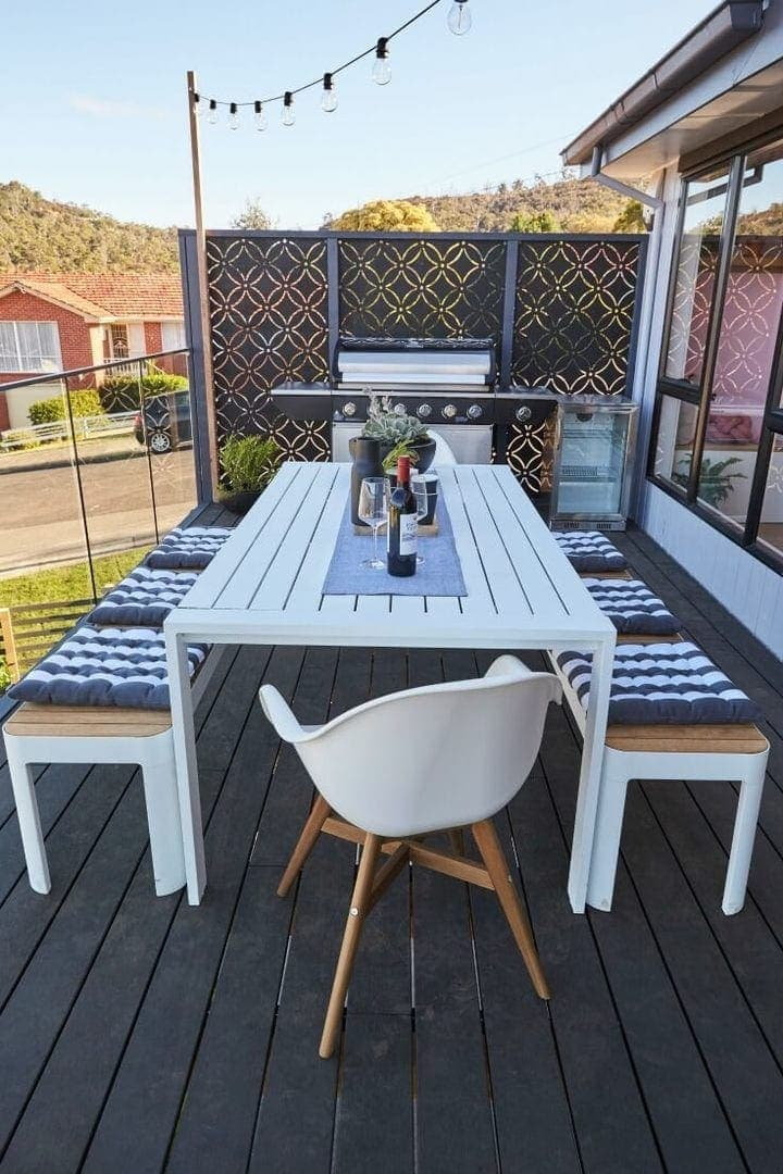 house rules 2017 sean and ella deck with bbq and white dining table
